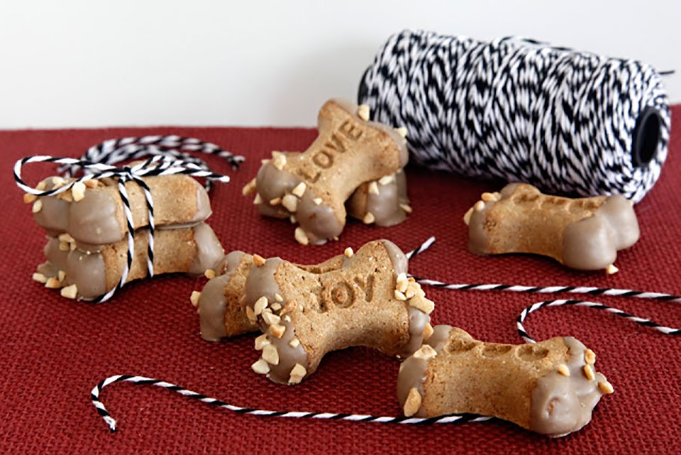 Carob dipped dog treats with peanut sprinkles