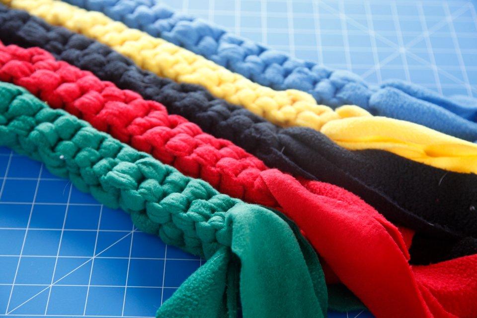 Colourful woven fleece dog tug toys