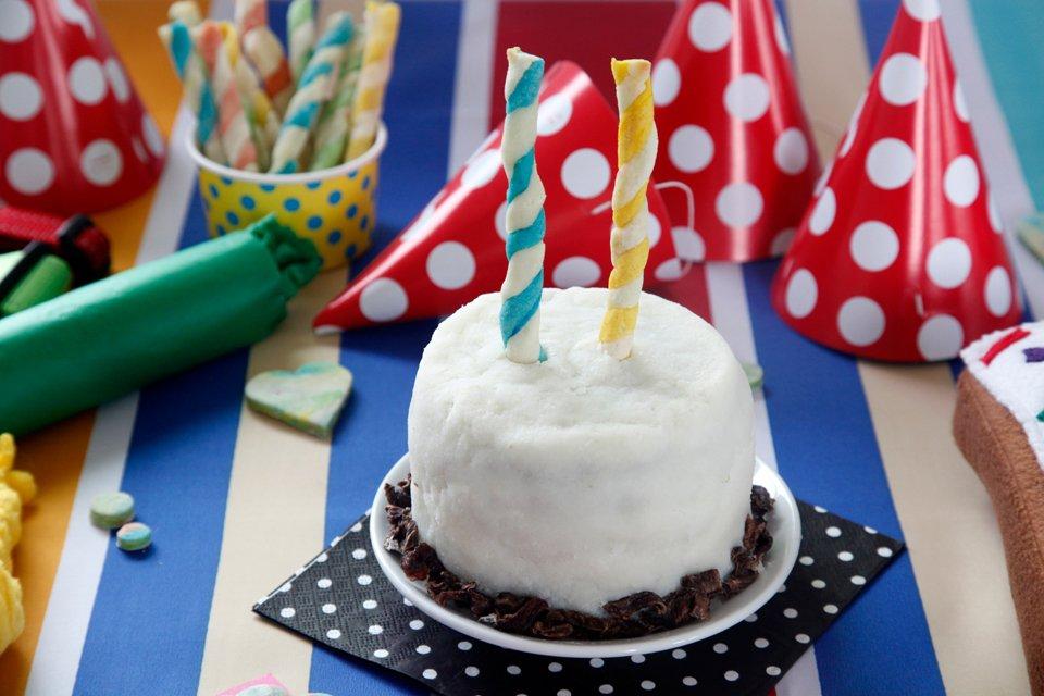 Homemade turkey meatloaf dog birthday cake with mashed potato frosting