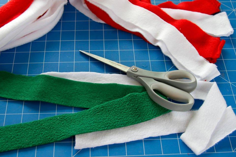 Cutting polar fleece strips to make a candy cane dog tug toy