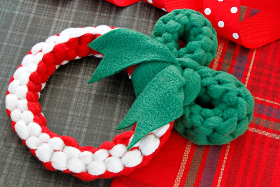 Homemade woven fleece Christmas wreath dog tug toy