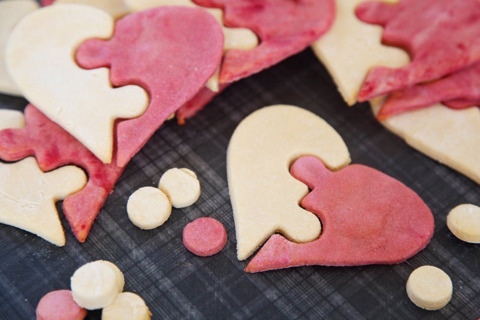 Homemade Valentine's Day pink and white puzzle heart dog treats