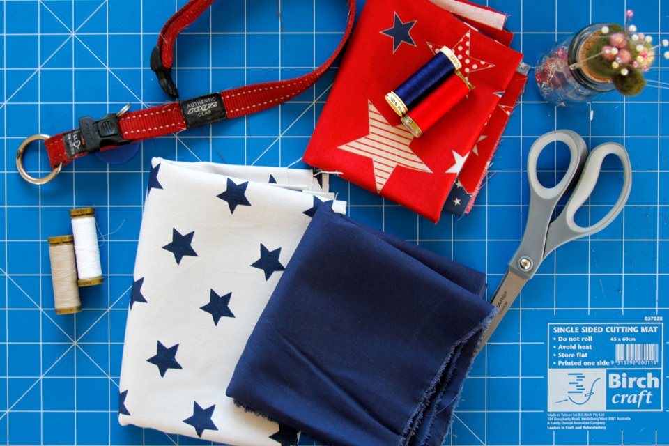 Materials for making DIY red while and blue Fourth of July dog bandanas