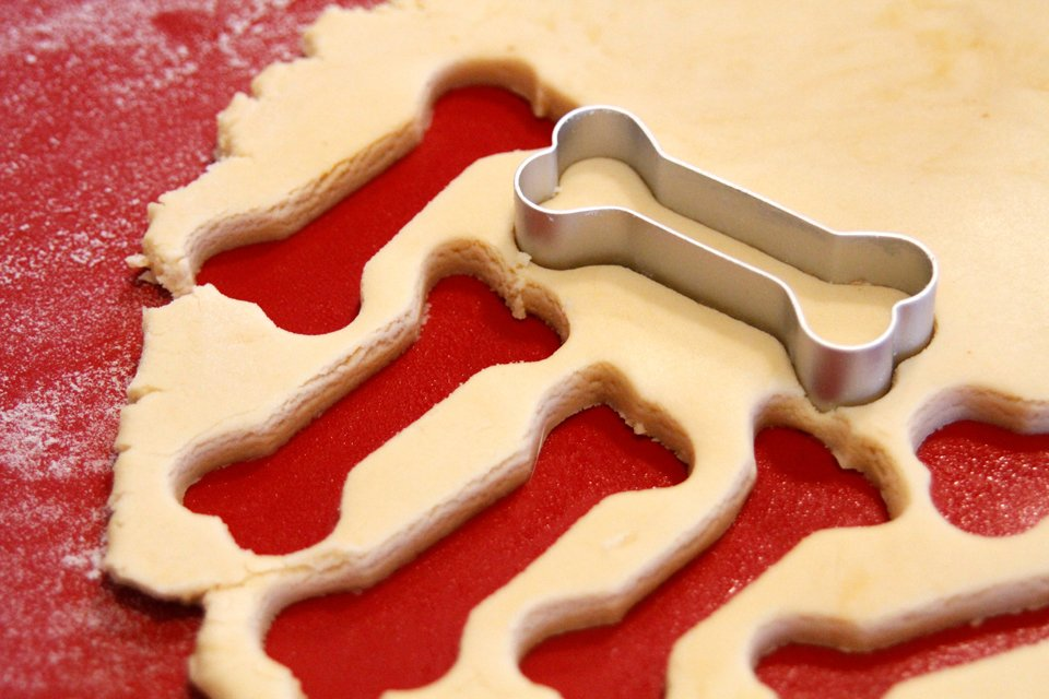 Cutting bone shaped peanut butter dog treats