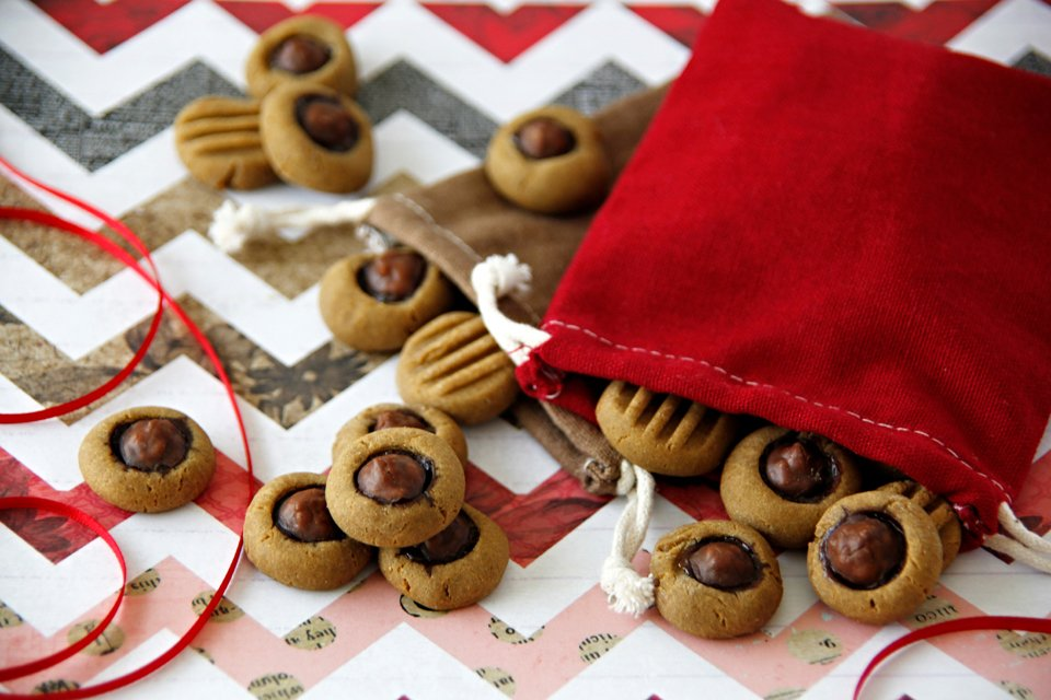 Peanut butter molasses dog treats topped with carob drop kisses.