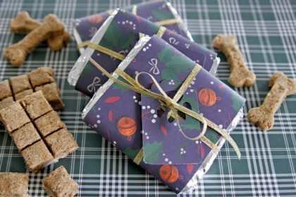 Homemade dog treat bars with Christmas wrappers