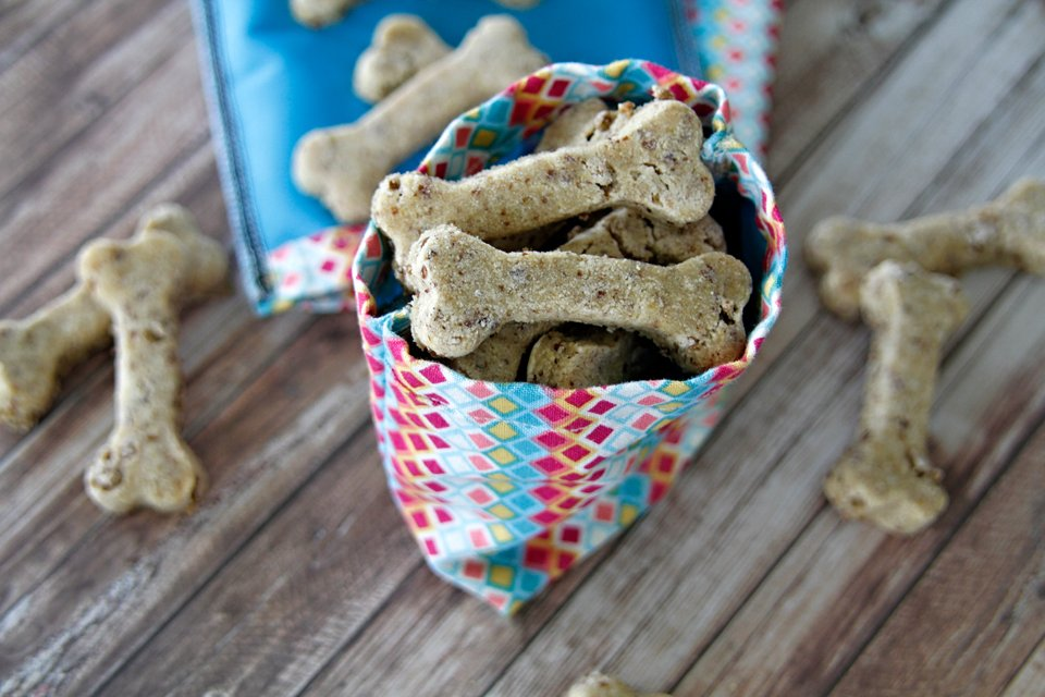 DIY dog treat bag with waterproof liner filled with homemade bone shaped dog treats