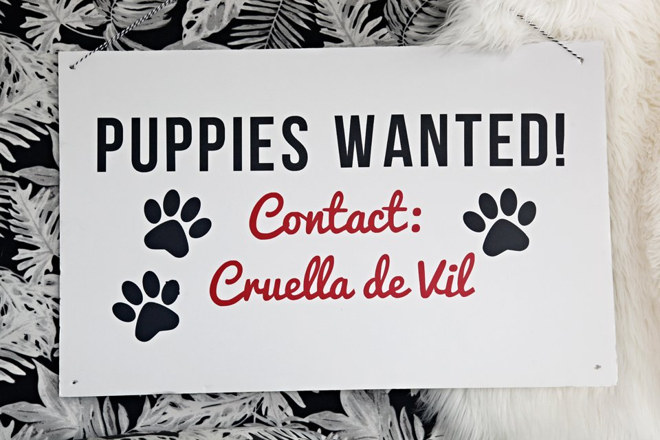 "DIY ""Puppies Wanted"" sign for Hundred and One Dalmatians Halloween decorations"