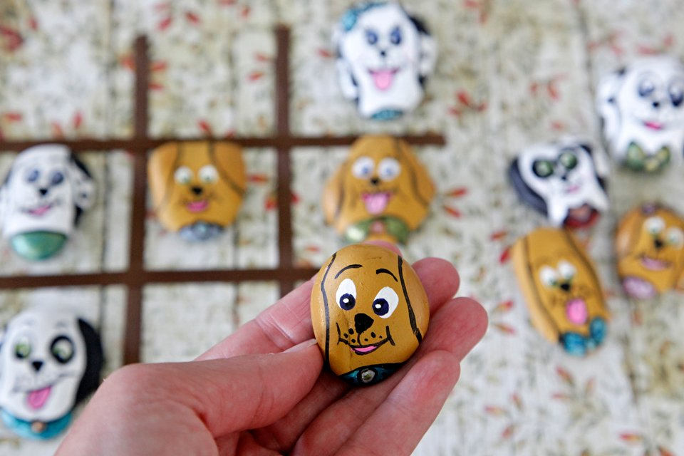 DIY painted puppy dog rock for homemade tic tac toe game