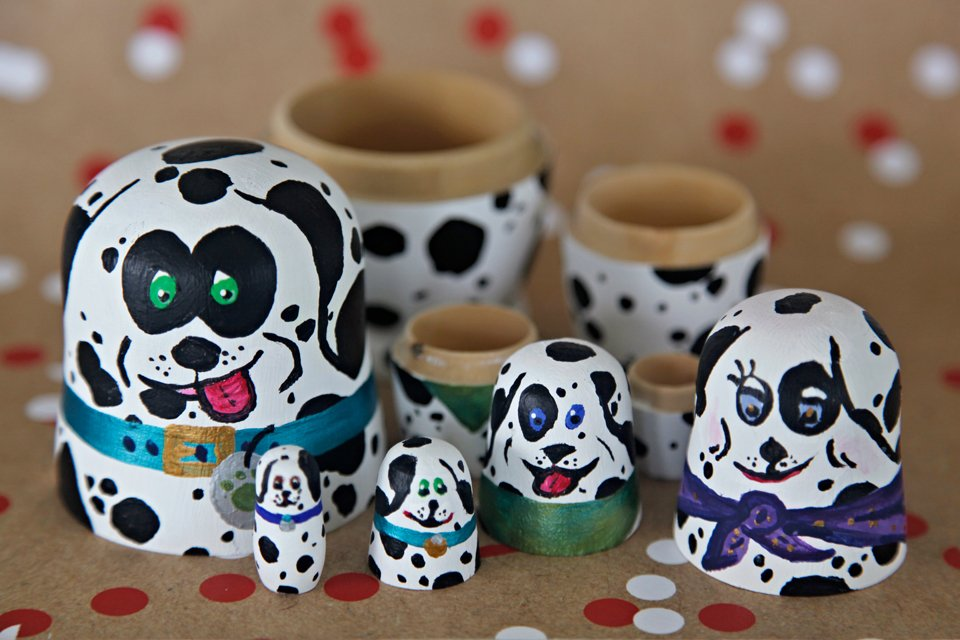 Nesting dolls painted to look like Dalmatian dogs