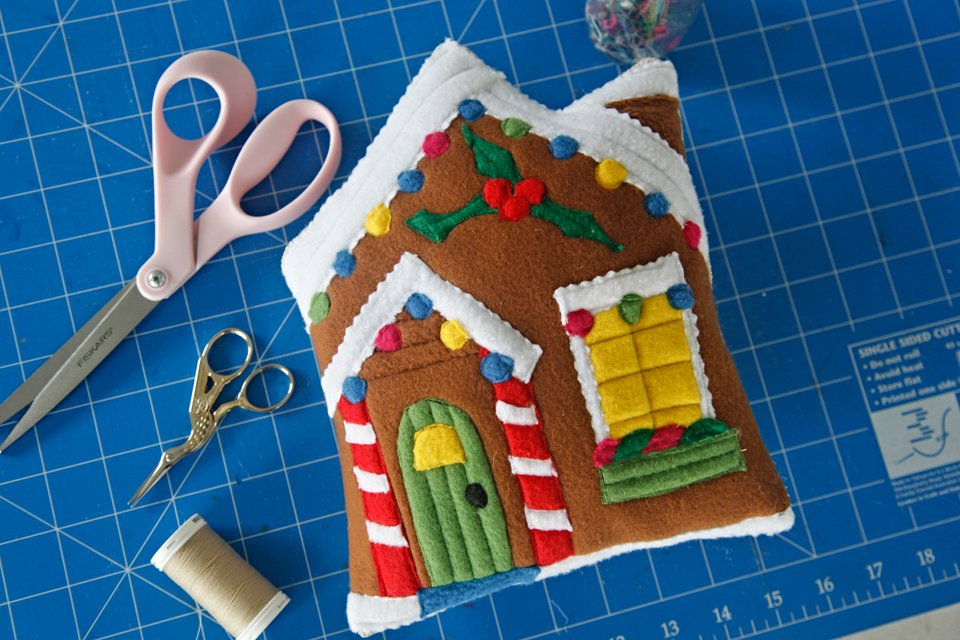 DIY stuffed gingerbread house dog toy on sewing mat